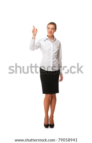 A young woman in a white blouse pointing at something, isolated on white