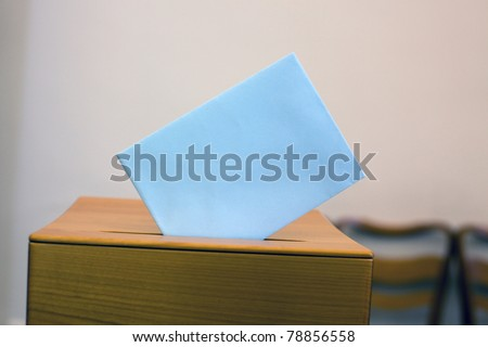 A young woman in an election shall deliver their vote. Ballot at the polling station. - stock photo