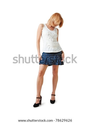 A young woman in short skirt and high heels over white background. - stock photo
