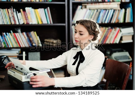 A young woman in the library - stock photo