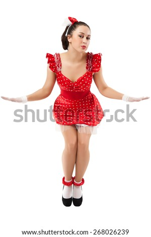 A young woman in the red dress depicts a doll. - stock photo