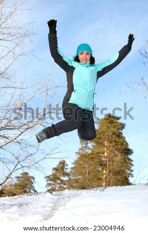 A young woman in the winter jump - stock photo