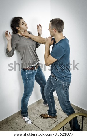 A young woman is attacked by a man - stock photo
