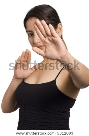 A young woman is doing tai chi moves over white background