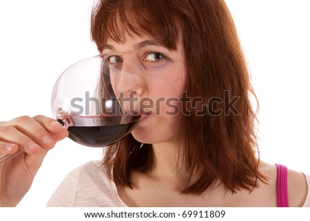 A Young woman is drinking red wine from a glass