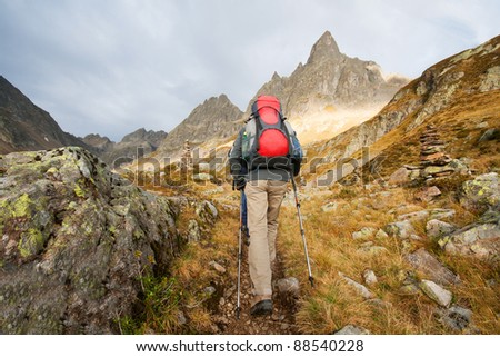 A young woman is hiking on the mountains - stock photo
