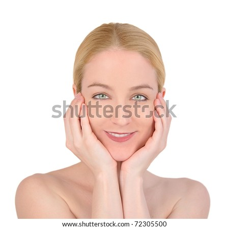 A young woman is holding her face and smiling on a white background. - stock photo