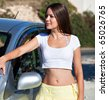 a young woman is near the car - stock photo