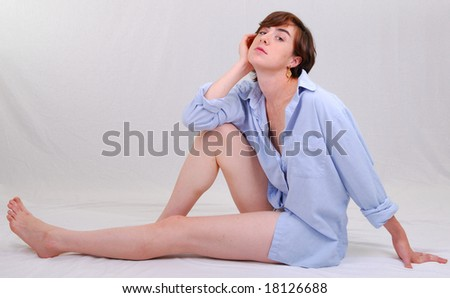 a young woman is sitting on the floor and glancing - stock photo