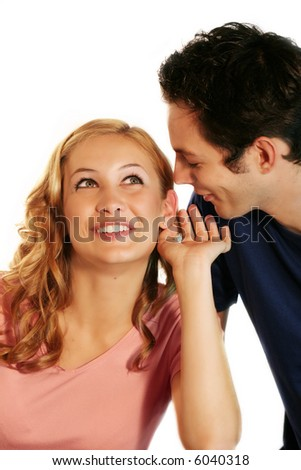 a young woman is smiling, while the man is whispering a secret - stock photo