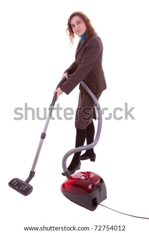 A young woman is vacuum-cleaning the floor with a hoover - stock photo