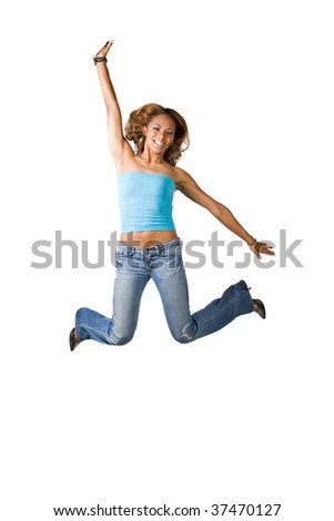 A young woman jumping and having fun.  Isolated over  a white background. - stock photo