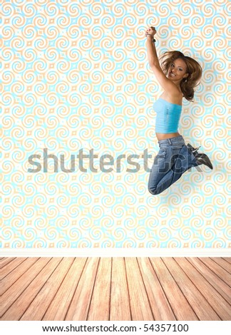 A young woman jumping in the air indoors in front of an interior decorated with vintage wallpaper. - stock photo
