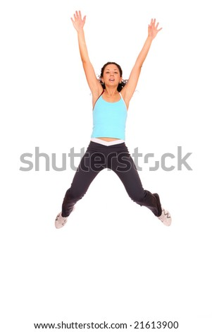 A young woman jumping with her hands up over white background