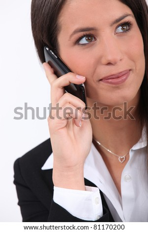 A young woman making a phone call. - stock photo