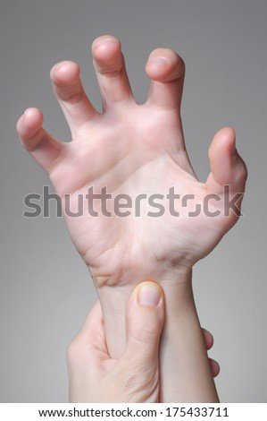 A young woman massaging her painful wrist - stock photo