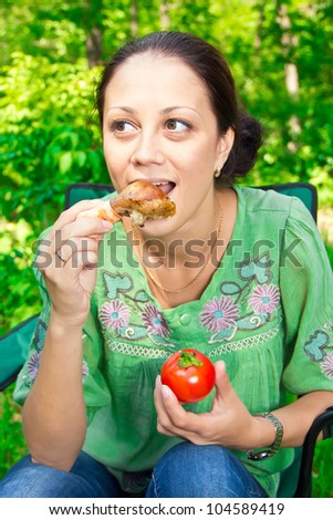 a young woman on a picnic - stock photo