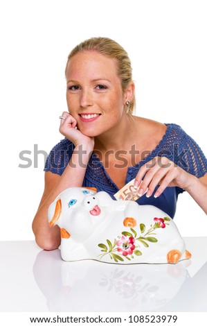 a young woman on a white background with a piggy bank. saving money as a pension. - stock photo