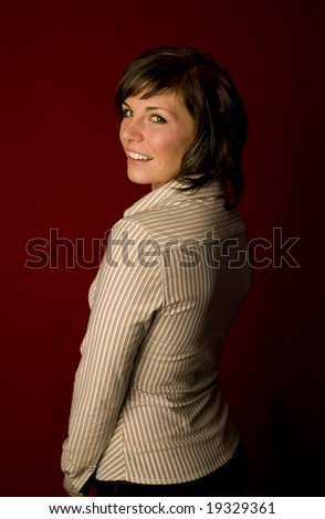 A young woman on red - stock photo