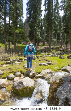 A young woman out hiking in the countryside, Kashmir