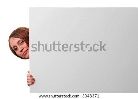 A young woman peeking out the side of a blank card waiting for advertising text. - stock photo