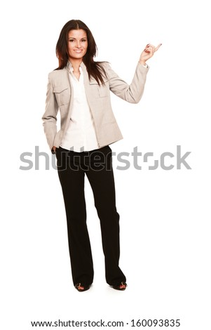 A young woman pointing at a copyspace isolated on a white background - stock photo