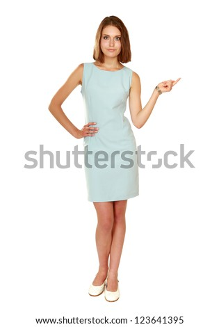 A young woman  pointing at something, isolated on white - stock photo