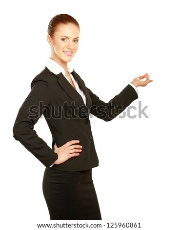 A young woman pointing at something, isolated on white background