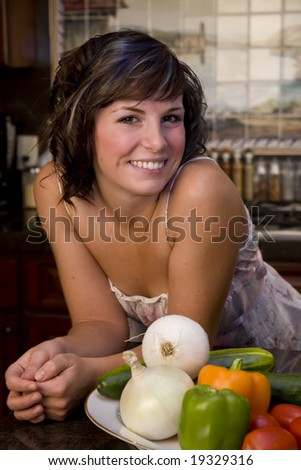 A young woman portrait in the kitchen - stock photo
