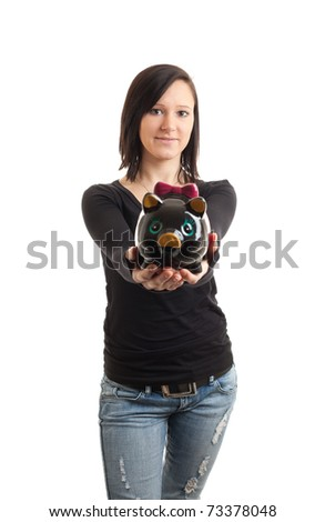 a young woman presenting a piggy bank to the camera - stock photo