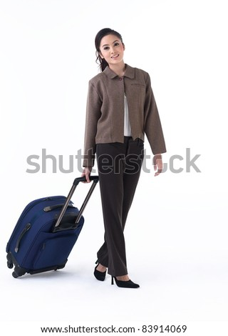 A young woman pulling her luggage