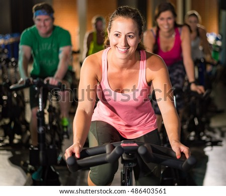 A Young Woman Riding a Stationary Bike for Exercise