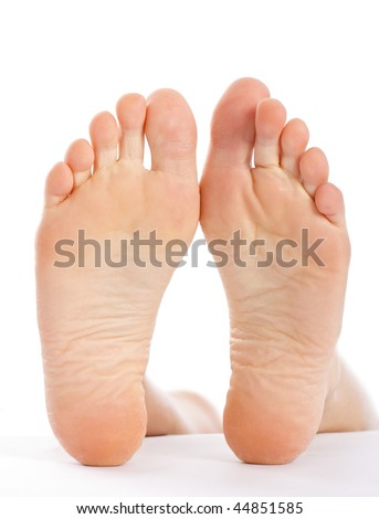 A young woman 's feet closeup, isolated on white with a specific texture of dry skin.