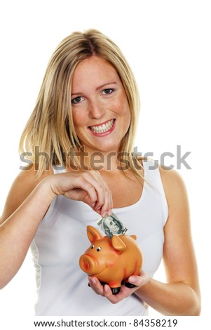 A young woman saves money and coins for the future. Care and save with dollar bill - stock photo