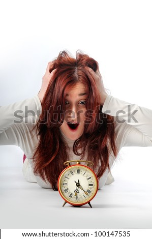 a young woman see a clock - stock photo