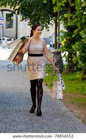 A young woman shopping with many shopping bags - stock photo