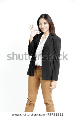 A young woman showing ok, isolated on white