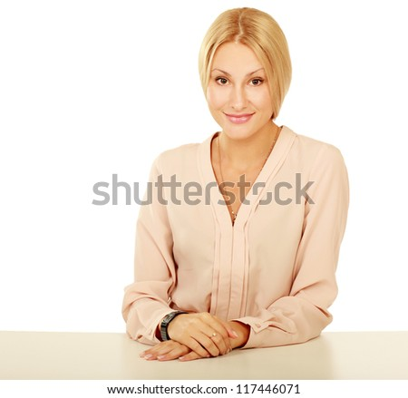 A young woman sitting at the desk, isolated on white background - stock photo