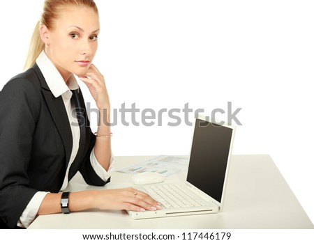 A young woman sitting with a laptop, isolated on white background - stock photo