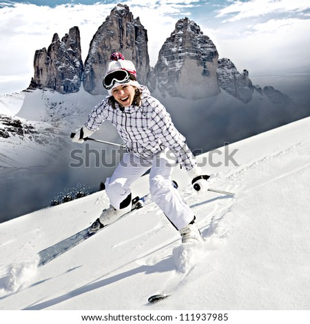 A young woman skiing in the Alps, an outdoor shoot. - stock photo