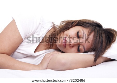 A  young woman sleeps in bed, set against a white background.