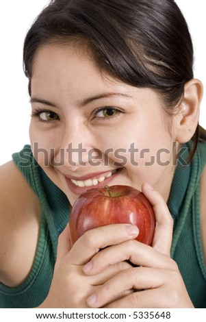 A young woman smiling  while holding an apple