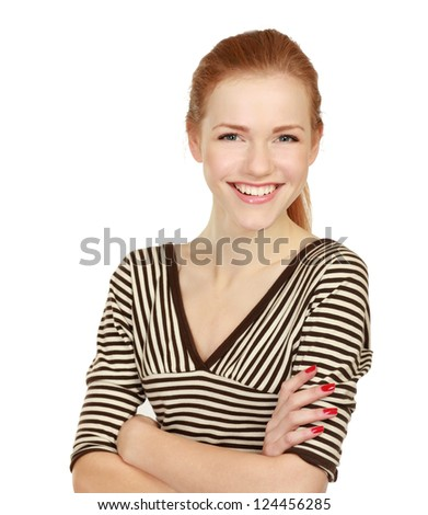 A young woman standing with folded arms, isolated on white background
