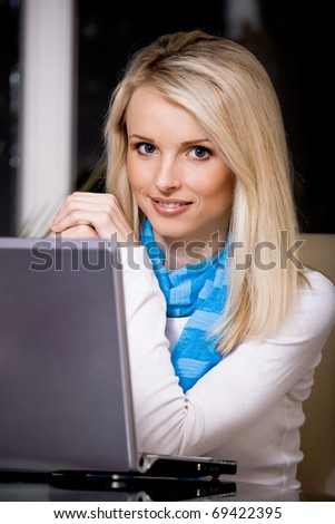 a young woman surging internet in the living room