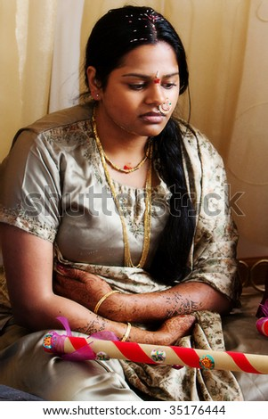 A young woman takes part in a pre-wedding ceremony - stock photo