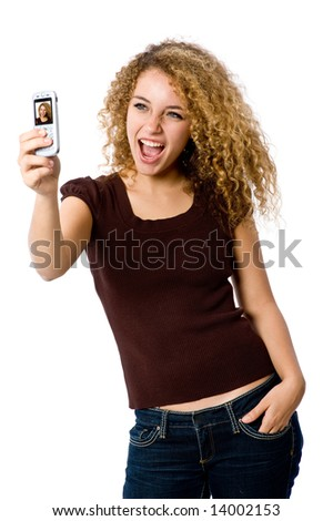 A young woman taking her self-portrait with a camera phone