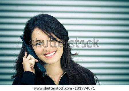 A young woman talking on a home wireless phone. color processed - stock photo