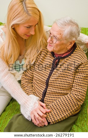 A young woman talking whit an older one expressing thrust and empathy - part of a series. - stock photo