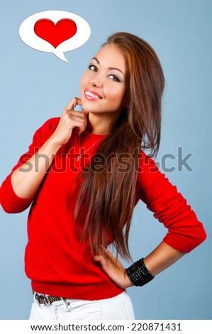 A young woman thinks about love - stock photo