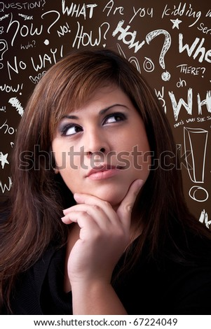 A young woman thinks deeply about something. Conceptual doodle question words float in the background. - stock photo